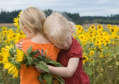 http://www.jungleoflife.com/wp-content/uploads/2011/12/girls-in-sunflowers.jpg